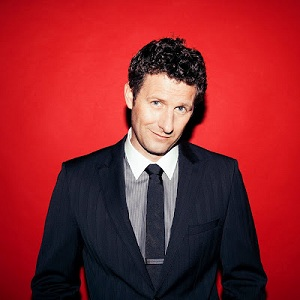... presenter Adam Hills is to host Australia's first 'mass gay TV wedding'.