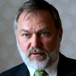 The video shows Scott Lively addressing a conference in Uganda