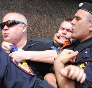 Activists with a rainbow flag are detained at Moscow Pride (Image: Simon S Cordall Twitter)