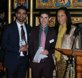 Helen Grant, pictured (R) presenting the award to InterTech's Asher Ismail, pictured far (L)