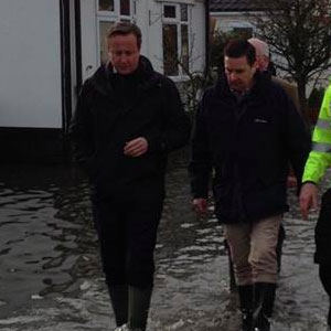 David Cameron visits a flooded town earlier this month