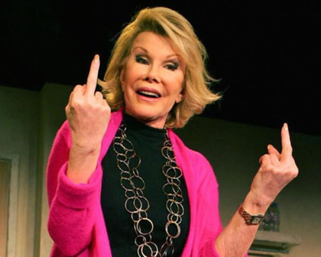 Joan Rivers flips off
