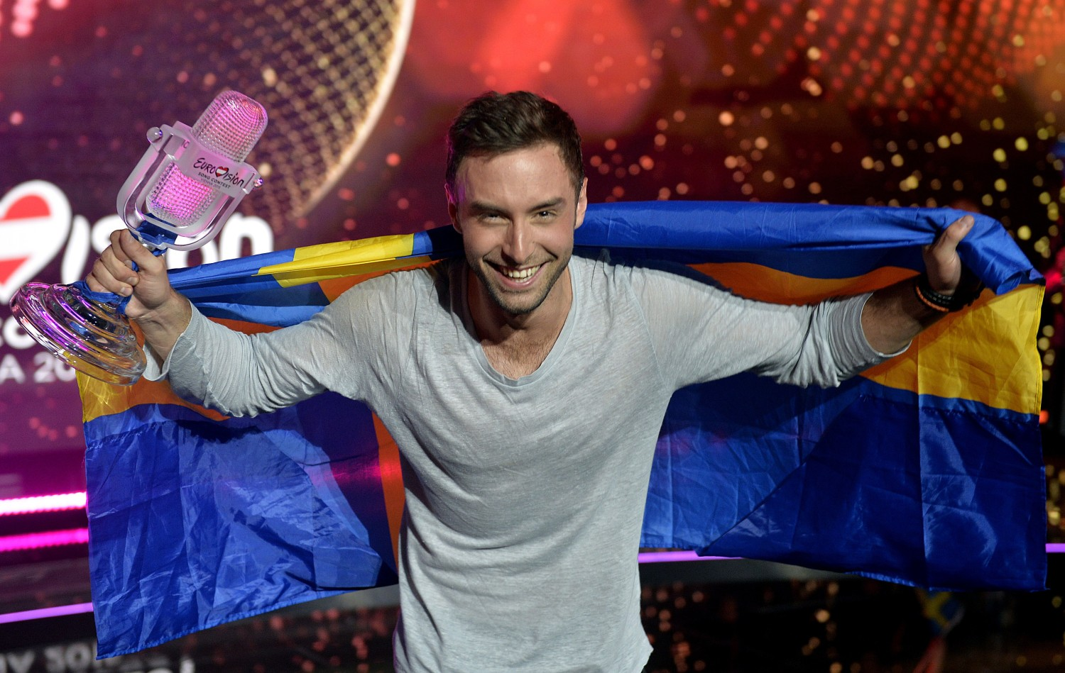Sweden's Mans Zelmerlow reacts after winning the Eurovision Song Contest final on May 23, 2015 in Vienna.   AFP PHOTO / SAMUEL KUBANI        (Photo credit should read SAMUEL KUBANI/AFP/Getty Images)