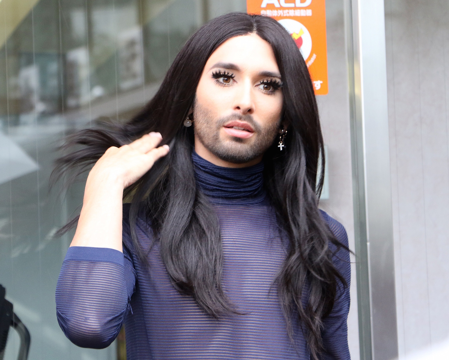"Drag queen singer Conchita Wurst of Austria leaves the Shibuya ward office in Tokyo on July 9, 2015, after he met with Shibuya ward chief Ken Hasebe. Shibuya ward decided to issue ""partnership"" certificates to gay couples this March since gay couples often have difficulty renting apartments and are stopped by hospitals from visiting loved ones because they do not have officially recognised family relationships.  AFP PHOTO / Yoshikazu TSUNO        (Photo credit should read YOSHIKAZU TSUNO/AFP/Getty Images)"