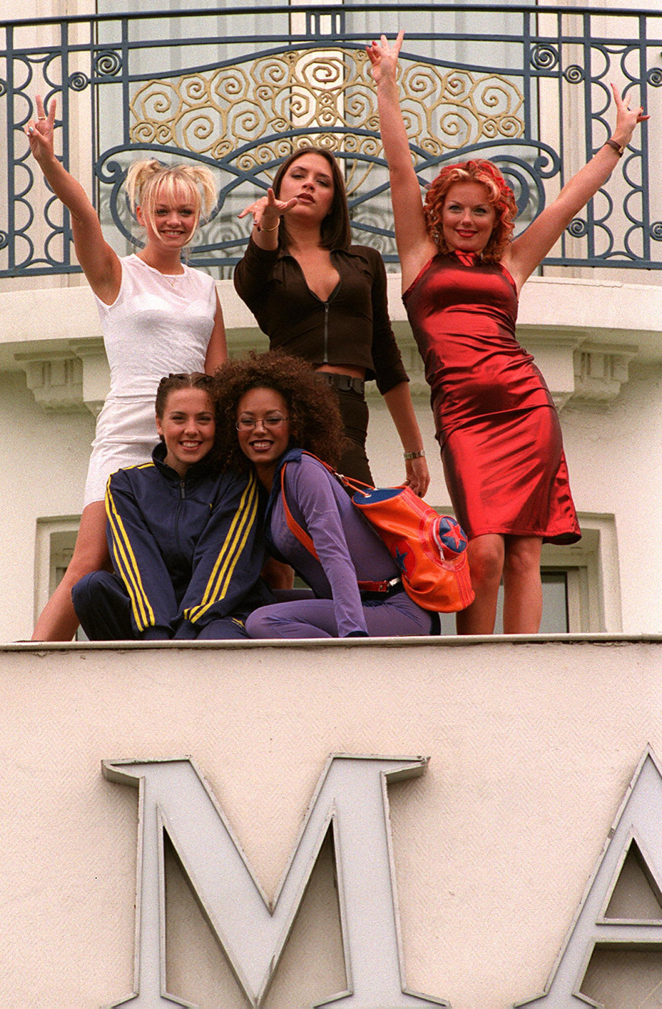(FILES) The Spice Girls pose for photogr