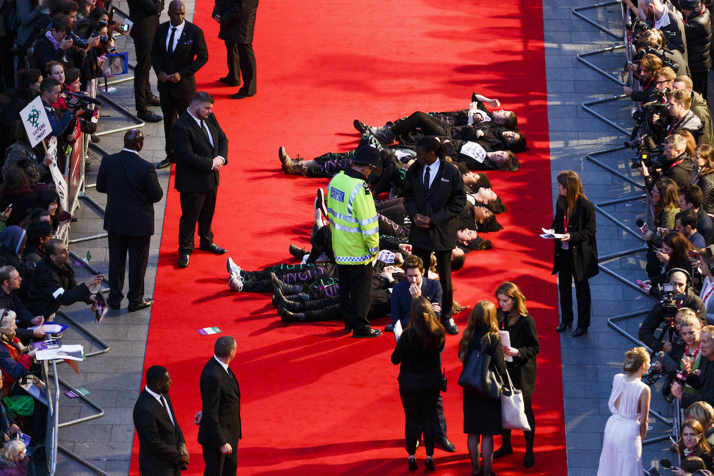 LONDON, ENGLAND - OCTOBER 07:  A feminist group Sisters Uncut protesting against cuts to support for victims of domestic violence  occupy the red carpet during a protest at the Suffragette premiere on the Opening Night Gala of the BFI London Film Festival at Odeon Leicester Square on October 7, 2015 in London, England.  (Photo by Tristan Fewings/Getty Images)