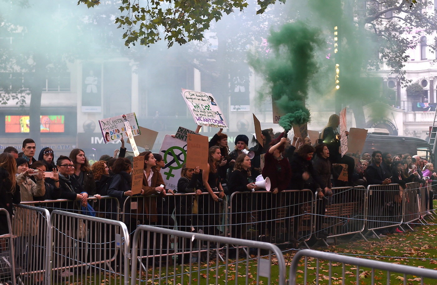 """LONDON, ENGLAND - OCTOBER 07:  A general view of protestors at the """"Suffragette"""" premiere at the Opening Night Gala during the BFI London Film Festival at the  Odeon Leicester Square on October 7, 2015 in London, England.  (Photo by Gareth Cattermole/Getty Images)"""