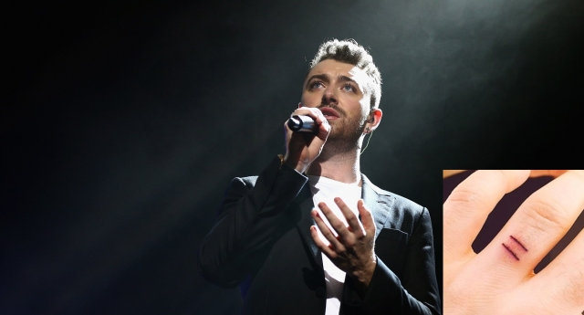 Sam Smith showed off his new tattoos (Photo by Cameron Spencer/Getty Images)