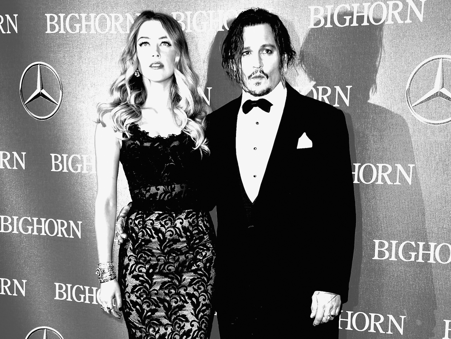 PALM SPRINGS, CA - JANUARY 02: (EDITORS NOTE: Image Converted from Color to BW). Actors Amber Heard and Johnny Depp arrive at the 27th Annual Palm Springs International Film Festival Awards Gala at Palm Springs Convention Center on January 2, 2016 in Palm Springs, California. (Photo by Frazer Harrison/Getty Images)