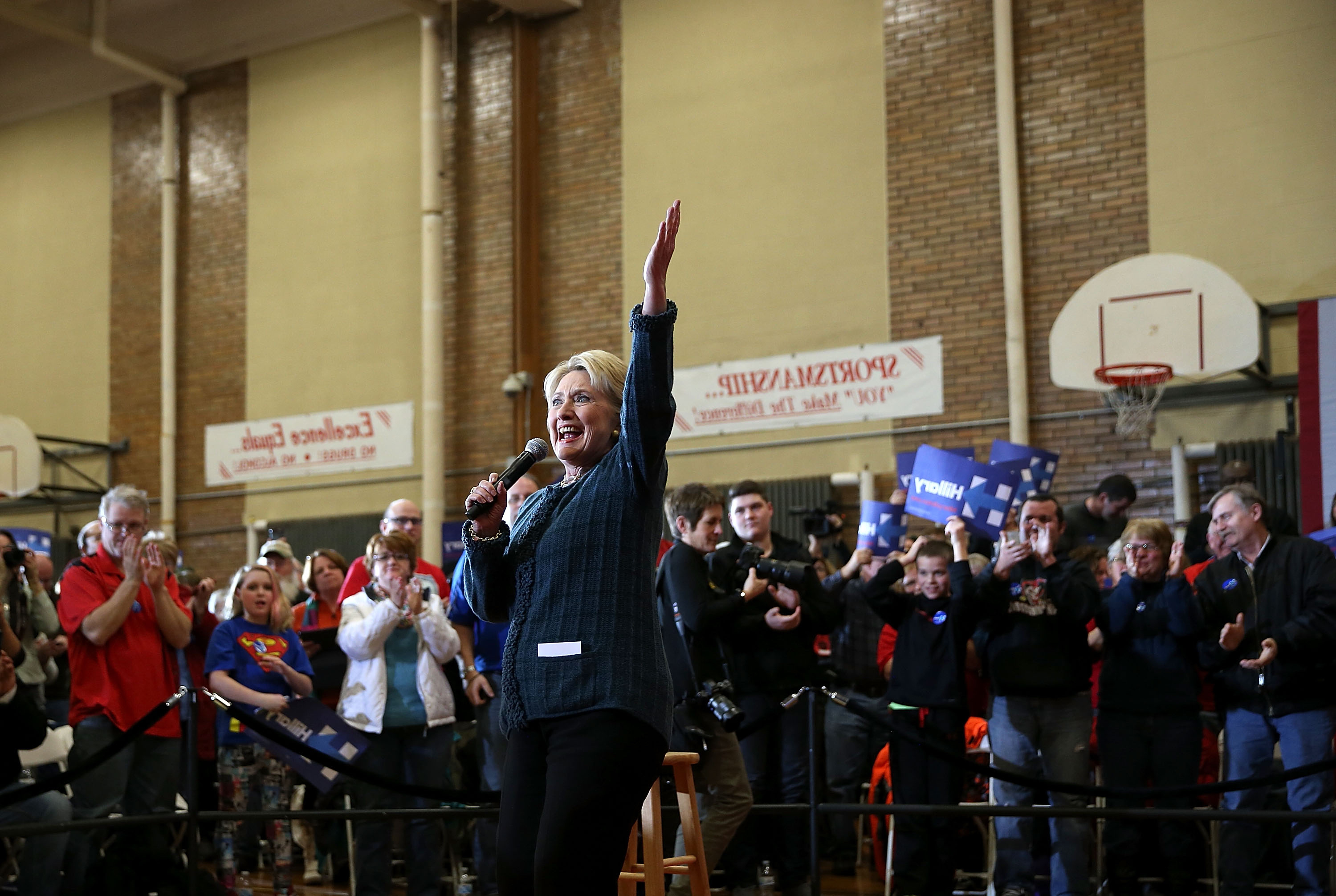 "MARSHALLTOWN, IA - JANUARY 26: Democratic presidential candidate former Secretary of State Hillary Clinton speaks during a ""get out the caucus"" event at BR Miller Middle School on January 26, 2016 in Marshalltown, Iowa. With less than a week to go before the Iowa caucuses, Hillary Clinton is campaigning throughout Iowa. (Photo by Justin Sullivan/Getty Images)"