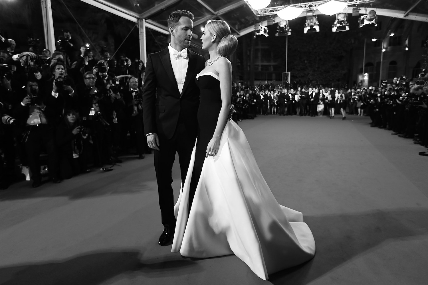"BLACK AND WHITE VERSION Canadian actor Ryan Reynolds and his wife US actress Blake Lively pose as they arrive for the screening of the film ""Captives"" at the 67th edition of the Cannes Film Festival in Cannes, southern France, on May 16, 2014.   AFP PHOTO / VALERY HACHE        (Photo credit should read VALERY HACHE/AFP/Getty Images)"