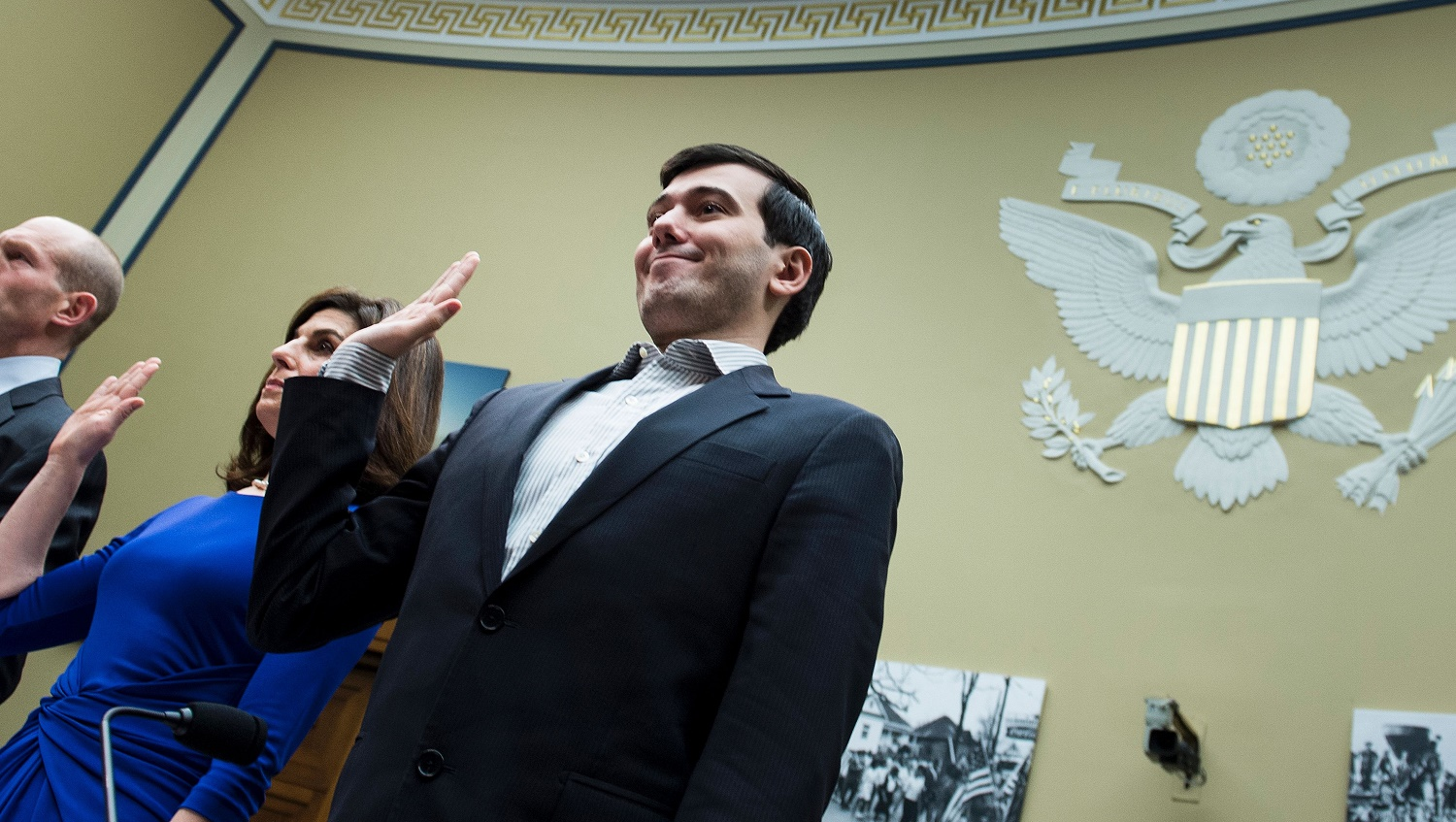 Entrepreneur and pharmaceutical executive Martin Shkreli (R) is sworn in with others during a hearing of the House Oversight and Government Reform Committee on Capitol Hill February 4, 2016 in Washington, DC. Martin Shkreli, the controversial former pharmaceuticals boss and hedge fund manager indicted on securities fraud charges, has been subpoenaed to appear at a hearing of a House of Representatives committee on oversight and government reform looking at the prescription drug market. / AFP / Brendan Smialowski        (Photo credit should read BRENDAN SMIALOWSKI/AFP/Getty Images)