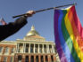 A pride flag is flown outside of the Massachusetts House of Representatives (Getty)