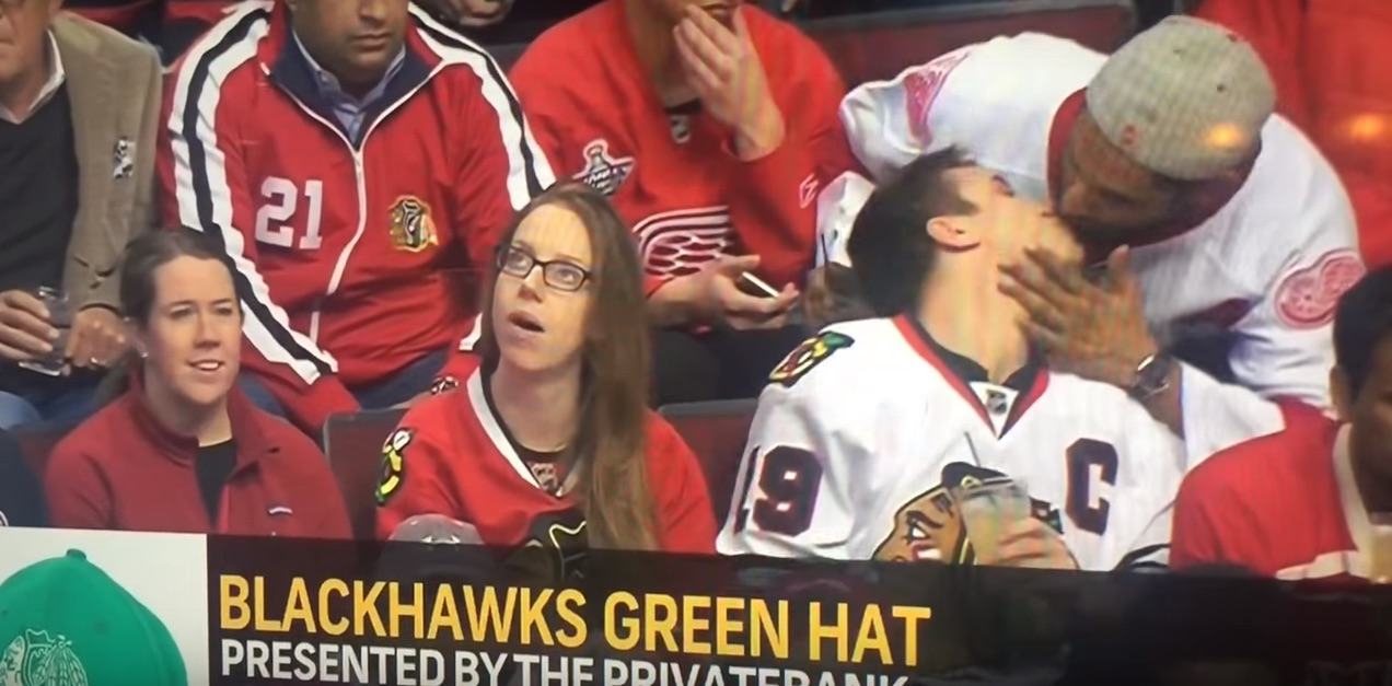 Rival hockey team guys share unexpected kiss-cam snog (VIDEO)