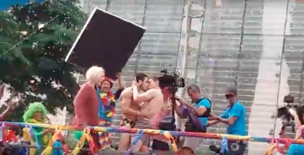 Brian J. Smith and Miguel Ángel Silvestre making out on a float