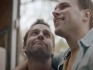 The ad features a gay couple moving into their new apartment