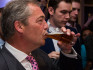 Nigel Farage celebrates victory with a pint