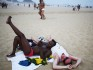 evelers relax on the beach during Rio de Janeiro's Pride festival (Photo by Mario Tama/Getty Images)