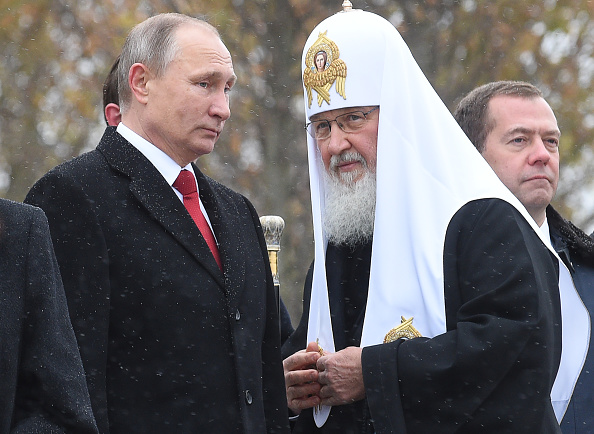 Russian President Vladimir Putin (L) speaks with Patriarch of Russia Kirill (R) as they attend the opening ceremony of the monument to Vladimir the Great in Moscow on November 4, 2016, as part of celebrations marking Russian National Unity Day. / AFP / SPUTNIK / Natalia KOLESNIKOVA (Photo credit should read NATALIA KOLESNIKOVA/AFP/Getty Images)