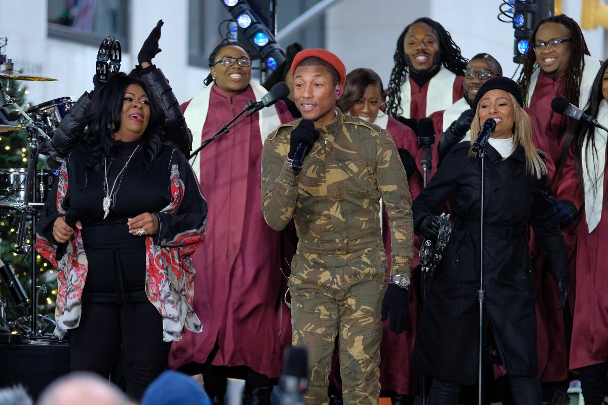 (L-R) Kim Burrell and Pharrell Williams perform at Citi Concert Series (Photo by D Dipasupil/Getty Images for CITI)