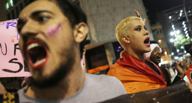 Pro-LGBT activists march in Rio de Janeiro (Photo by Mario Tama/Getty Images)