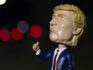 A Trump bobblehead on sale (Photo by  MOLLY RILEY/AFP/Getty Images)