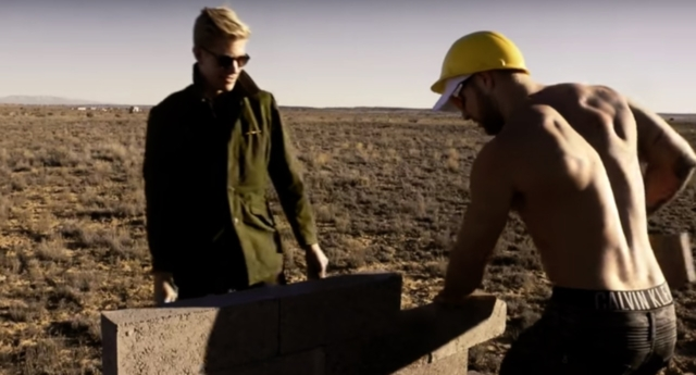 Milo supervising the building of 'the wall' (YouTube)