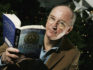 Philip Pullman with his book Northern Lights (MJ Kim/Getty Images)