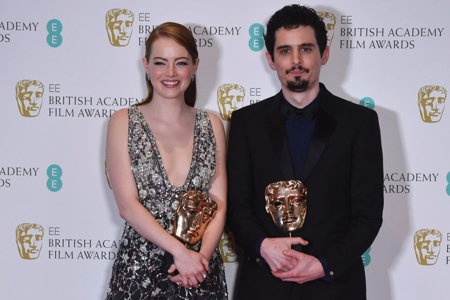 Emma Stone (left) with Damien Chazelle with their Baftas (BEN STANSALL/AFP/Getty Images)