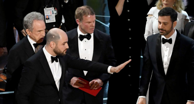 La La Land' producer Jordan Horowitz (C) stops the show to announce the actual Best Picture winner as 'Moonlight' following a presentation error (Photo by Kevin Winter/Getty Images)