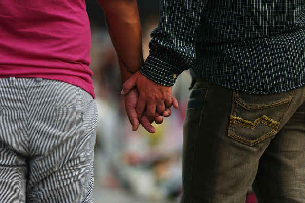 Getty; Gay couple holding hands.