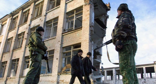 Members of Russia's special police forces stand guard in Grozny (Photo by VIKTOR DRACHEV/AFP/Getty Images)