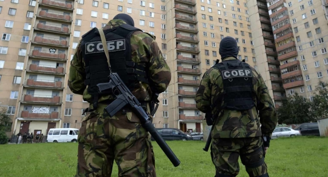 One man says that every day police and officers of the Interior Ministry's SOBR special-police unit would come to the house and pressure his relatives, demanding that they persuade him to return. (Photo by Olga Maltseva/AFP/Getty Images)