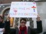 Demonstrators hold placards as they protest outside Church House (Getty Images)