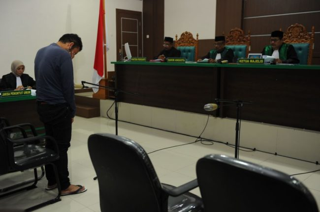 An Indonesian man attends his trial at a shariah court in Banda Aceh