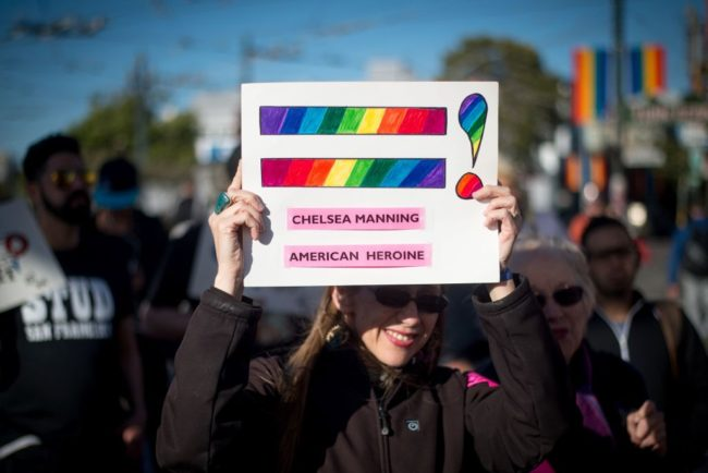 Holly Severson holds up a sign showing support for Chelsea Manning in the Castro District of San Francisco, California on May 17, 2017, during a celebration for Manning's release. Manning, the transgender army private jailed for one of the largest leaks of classified documents in US history, was released from a maximum-security prison in Kansas May 17, after seven years behind bars. / AFP PHOTO / Josh Edelson (Photo credit should read JOSH EDELSON/AFP/Getty Images)