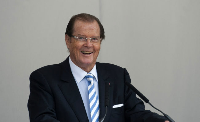British film actor Roger Moore speaks at a memorial to the late film director and restaurant critic Michael Winner