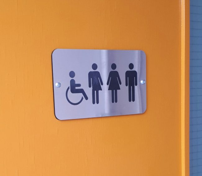 DCU gender-neutral bathroom sign