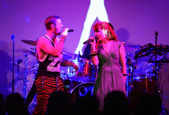 NEW YORK, NY - JUNE 07:  Ana Matronic and Jake Shears of the band Scissor Sisters perform during the 3rd annual amfAR Inspiration Gala New York at The New York Public Library - Stephen A. Schwarzman Building on June 7, 2012 in New York City.  (Photo by Jason Kempin/Getty Images)