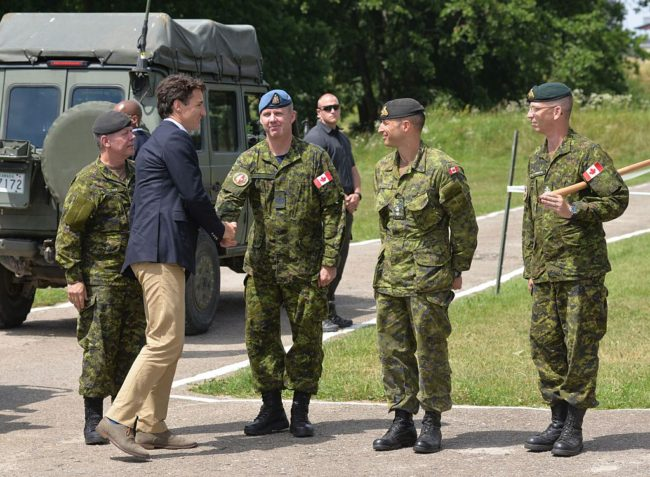 Justin trudeau shakes hands with instructor