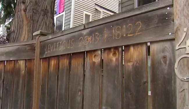 A man engraved his fence with homophobic Bible verses after his neighbours hung Pride flags outside of their house