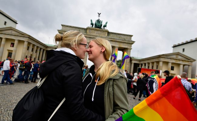 Two women kiss as they attend a rally of gays and lesbian