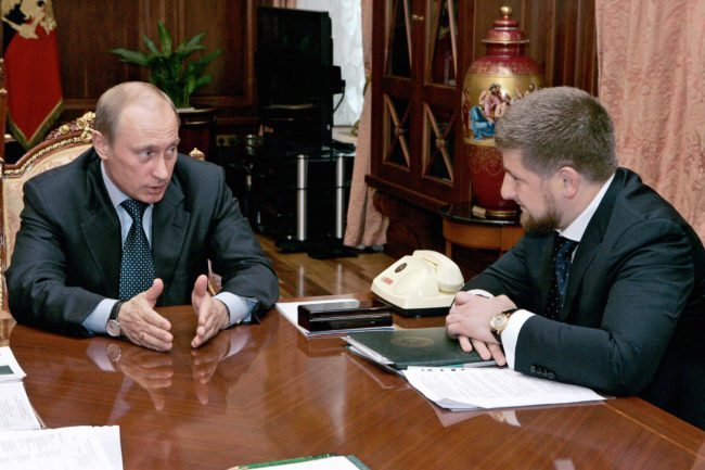 "ST.PETERSBURG, RUSSIAN FEDERATION: Russian President Vladimir Putin (L) speaks to Chechen Prime Minister Ramzan Kadyrov during their meeting at the Kremlin in Moscow, 05 May 2006. The pro-Russian prime minister of Chechnya, Ramzan Kadyrov, said 02 May that his militia, accused of conducting a reign of terror, was being reassigned and placed under Russian command. ""The structures no longer exist,"" the Itar-Tass news agency cited Kadyrov as saying about transferring responsibility for the militia which until now was part of the Chechen anti-terrorist unit. AFP PHOTO / ITAR-TASS / PRESIDENTIAL PRESS SERVICE (Photo credit should read SERGEI ZHUKOV/AFP/Getty Images)"