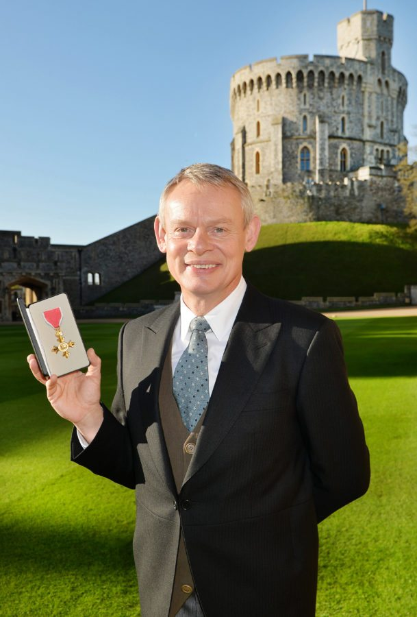 Martin Clunes poses with his OBE, 2015