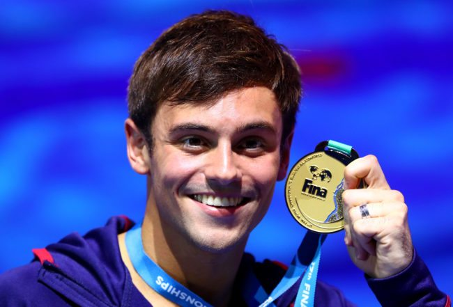 Tom Daley poses with his gold medal, 2017