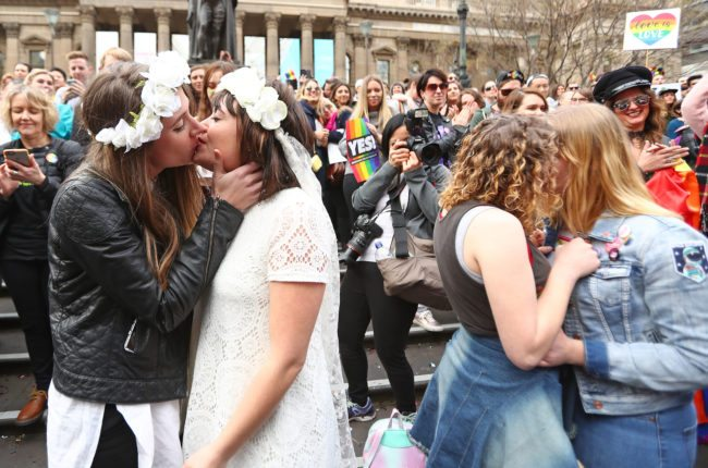 Couples kiss at the conclusion of an Illegal Wedding