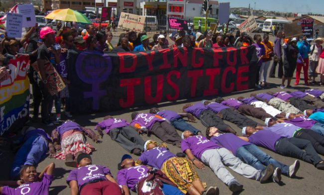 LGBT activists speak out against violence against LGBT women at Pride in Soweto, Johannesburg, in 2012