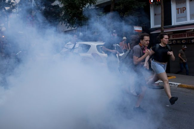 LGBT supporters run from tear gas fired by police after attempting to carry out the banned 2017 Istanbul Pride. (Photo by Chris McGrath/Getty Images)