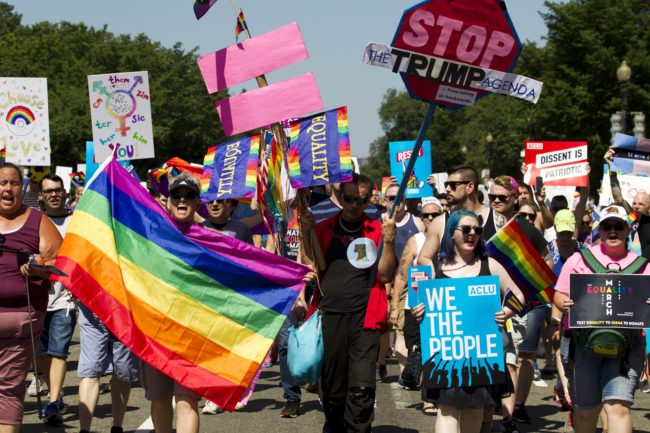 Pride marchers hit out against Trump with their signs at DC Pride 2017