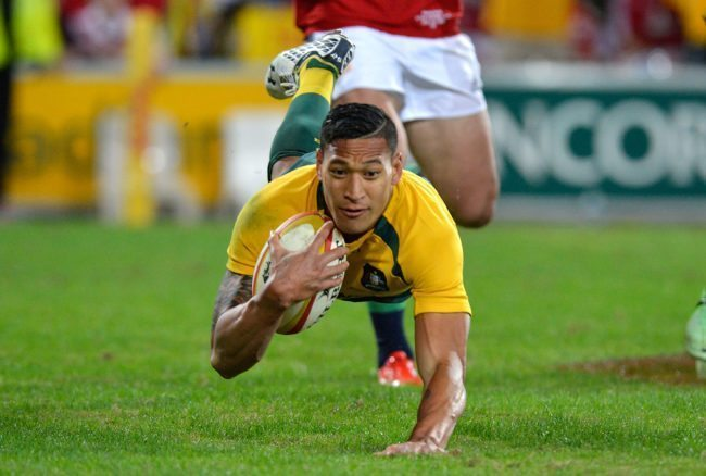 BRISBANE, AUSTRALIA - JUNE 22: Israel Folau of the Wallabies scores a try during the First Test match between the Australian Wallabies and the British & Irish Lions at Suncorp Stadium on June 22, 2013 in Brisbane, Australia. (Photo by Bradley Kanaris/Getty Images)